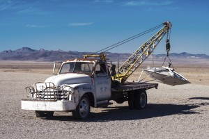 RACHEL, NEVADA - NOVEMBER 10: In front of the Little A'Le'Inn on November 10, 2013. An old tow truck hoists a UFO at the Little A'Le'Inn, which draws tourists from across the world